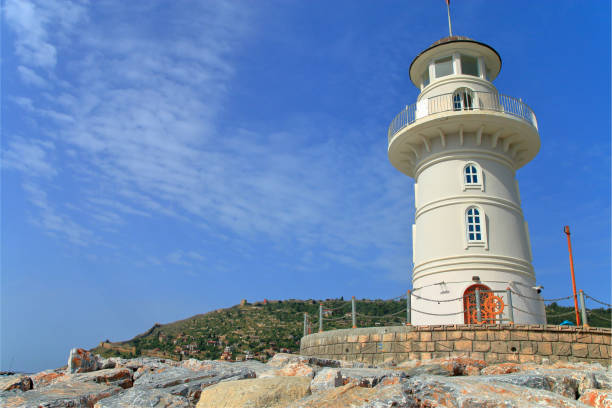 Old lighthouse in the harbor of the city of Antalya.