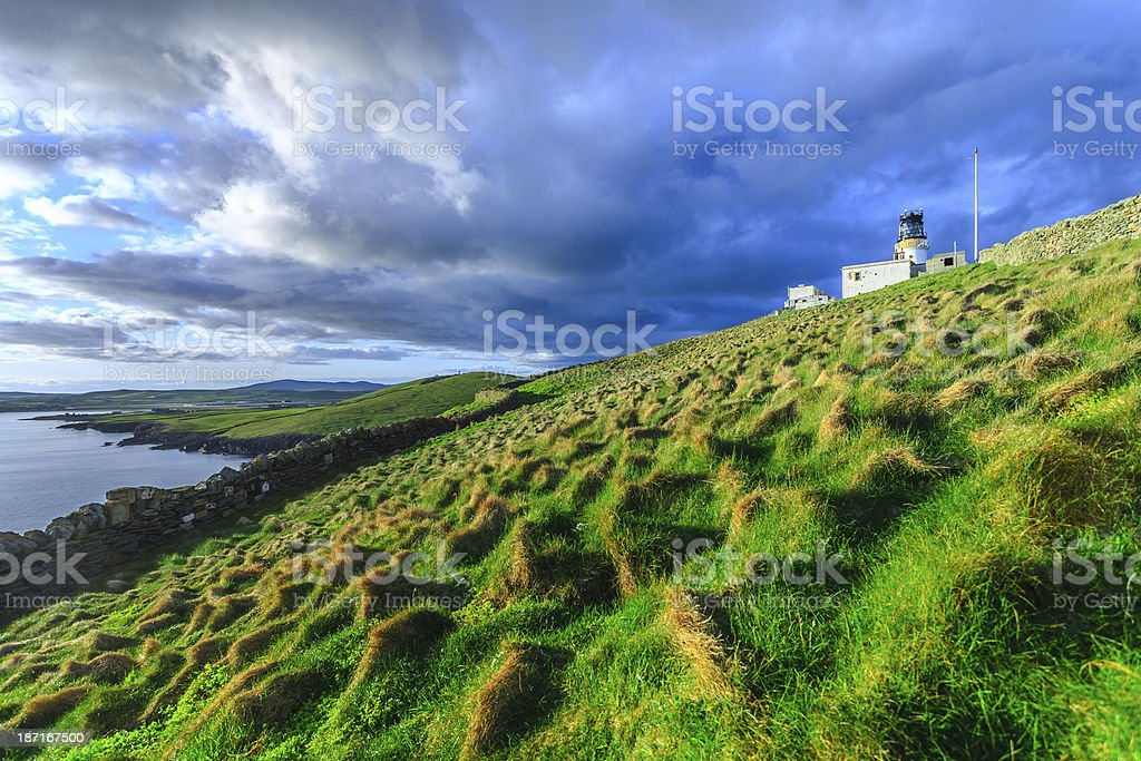 Old lighthouse on isolated island stock photo