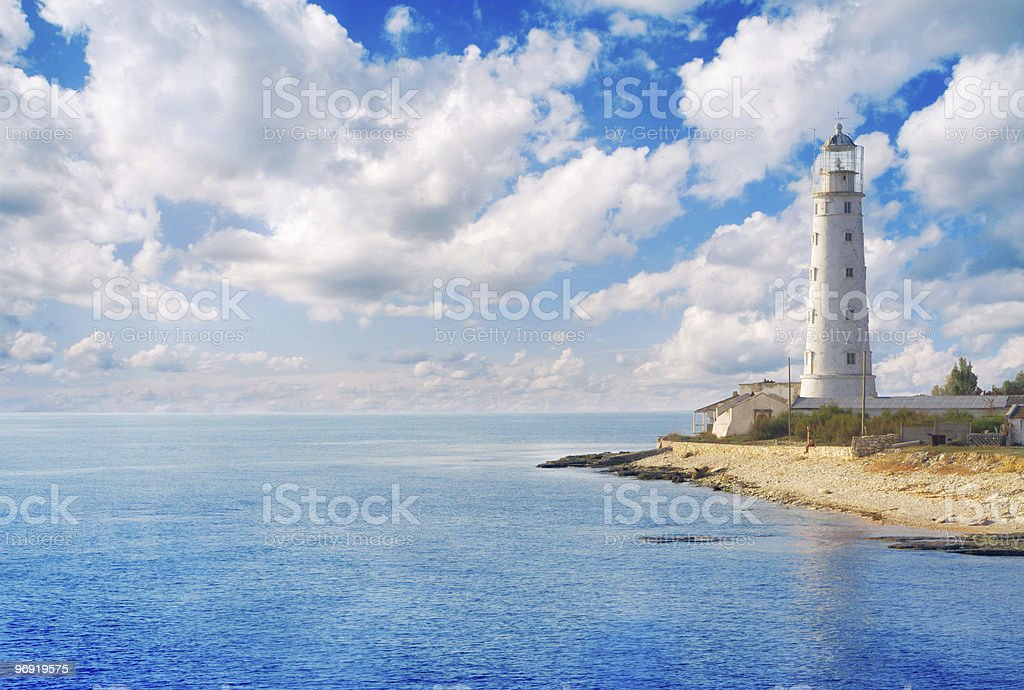 Old lighthouse on sea coast royalty-free stock photo