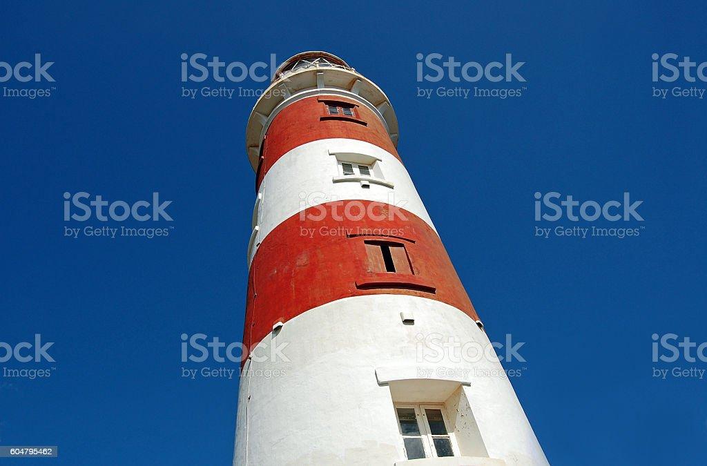 Old lighthouse on sky background stock photo