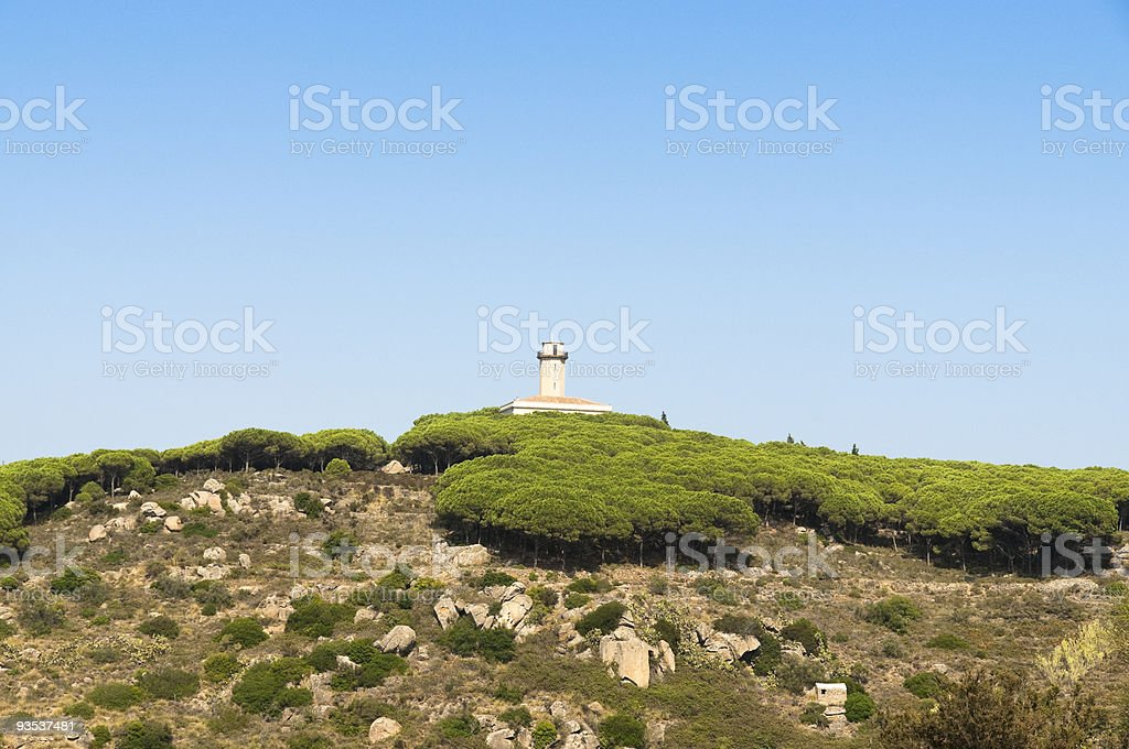 Old lighthouse on the isle of Giglio stock photo