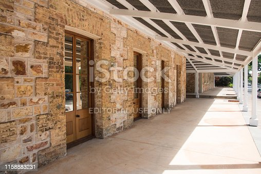 Darwin, Northern Territory, Australia-November 19,2017: Old limestone courthouse building with doors and low doorknobs in Darwin, Australia