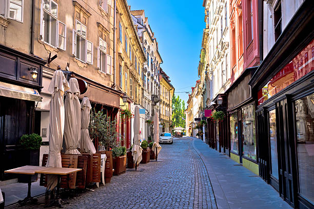 Old Ljubljana cobbled street view Old Ljubljana cobbled street view, capital of Slovenia ljubljana stock pictures, royalty-free photos & images