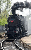 Old locomotive on the railway track