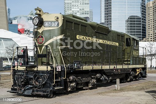 Toronto, Ontario, Canada - January 12 2019: Old locomotive at the Roundhouse Park (National Rail Museum) near the CN tower.  Touristic Attraction.
