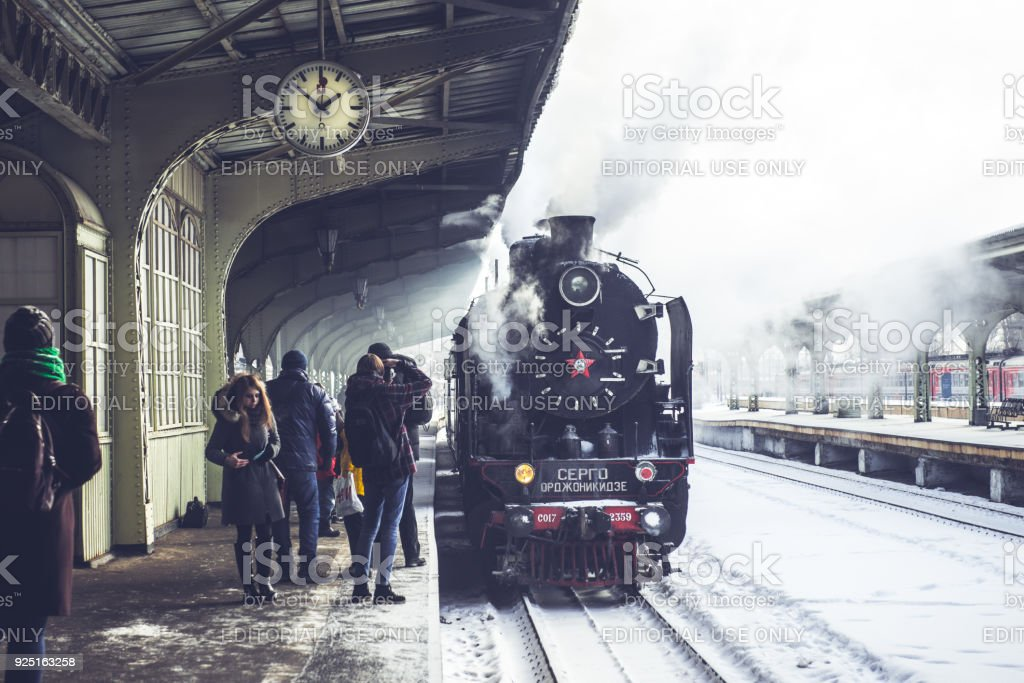 Old locomotive stopped at the station. Retro train on Vitebsky railway station in Saint-Petersburg, Russia, 25 february 2018 stock photo