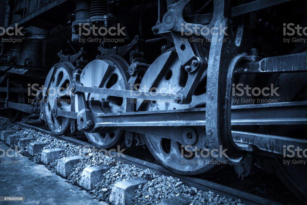 Old locomotive wheels close up. stock photo