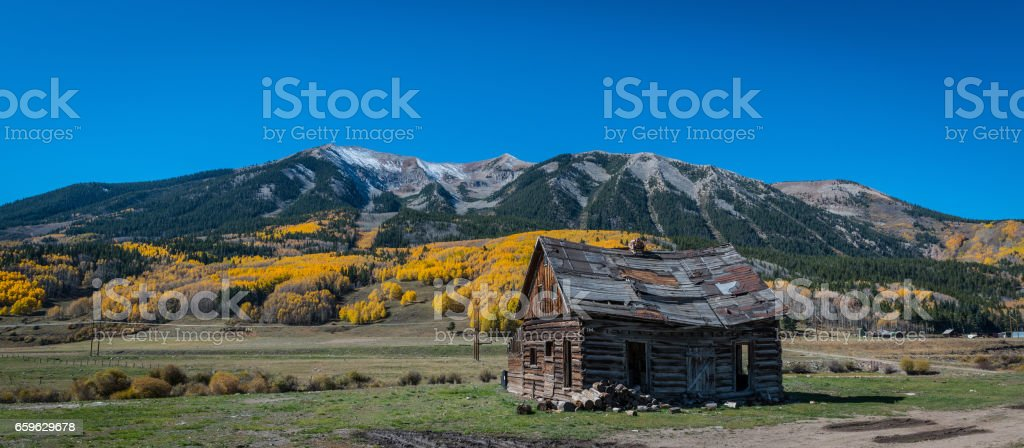 Old log cabin in Gunnison Country Colorado stock photo