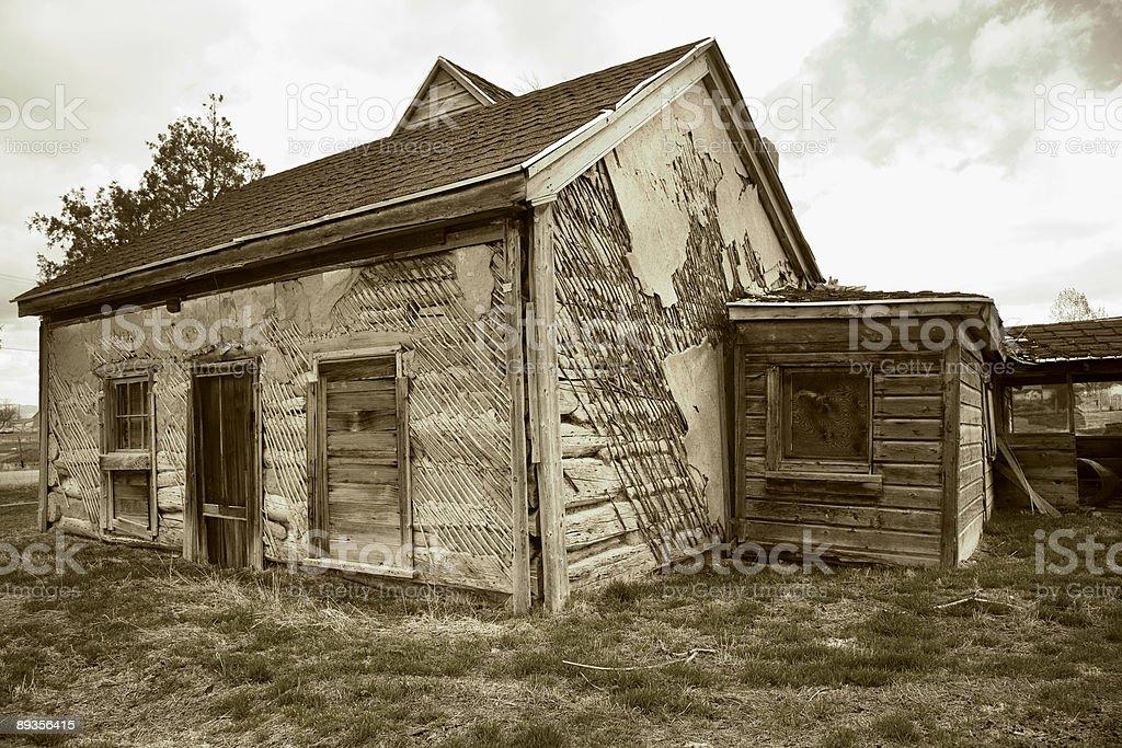 Vecchio registro casa, con vecchie Stucco esterno. foto stock royalty-free