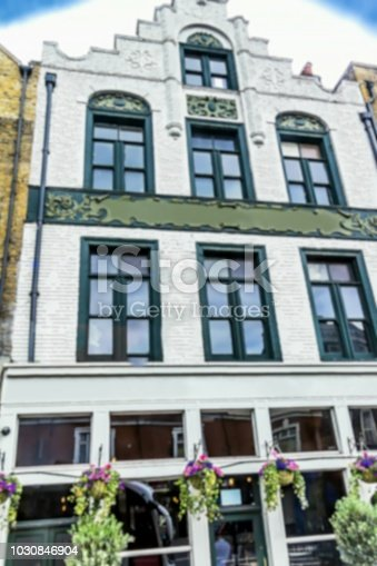 istock Old London building with traditional pub . Blurred view 1030846904