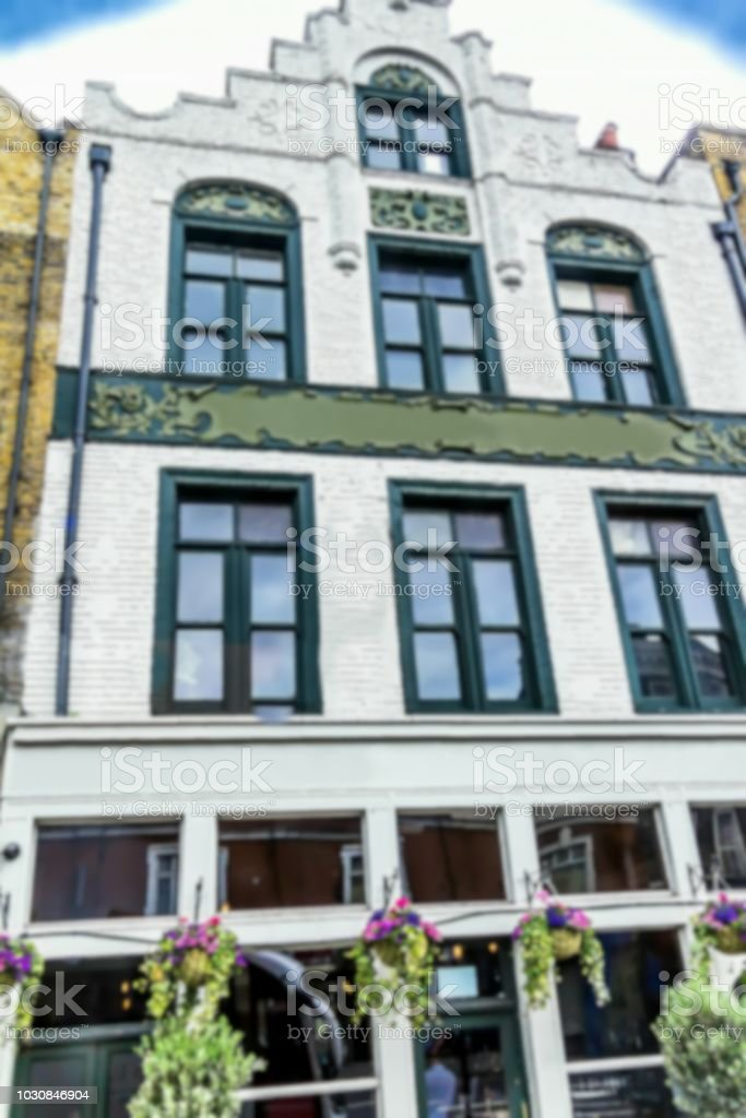 Old London building with traditional pub . Blurred view stock photo