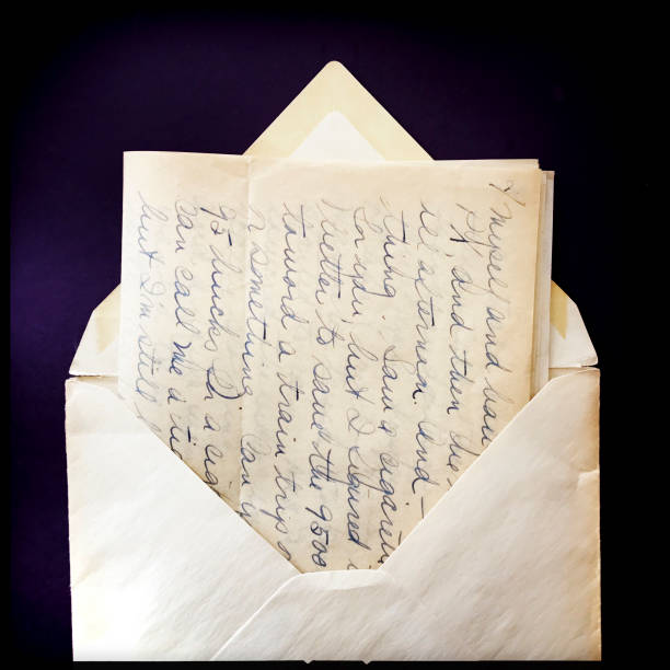 Old Love Letter and Envelope with Border Old love letter and envelope on deep dark purple black background with border.  iPhone taken on mobile device stock pictures, royalty-free photos & images