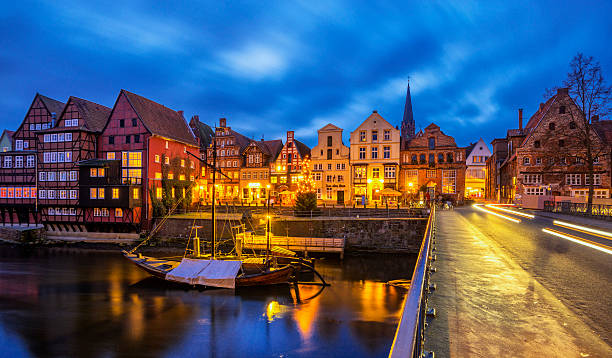 Old Luneburg (Luneberg) Harbour at night View on the Stintmarkt and Old Lüneburg harbour at dusk  lüneburg stock pictures, royalty-free photos & images