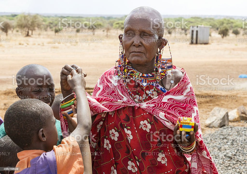 Old maasai woman and children stock photo