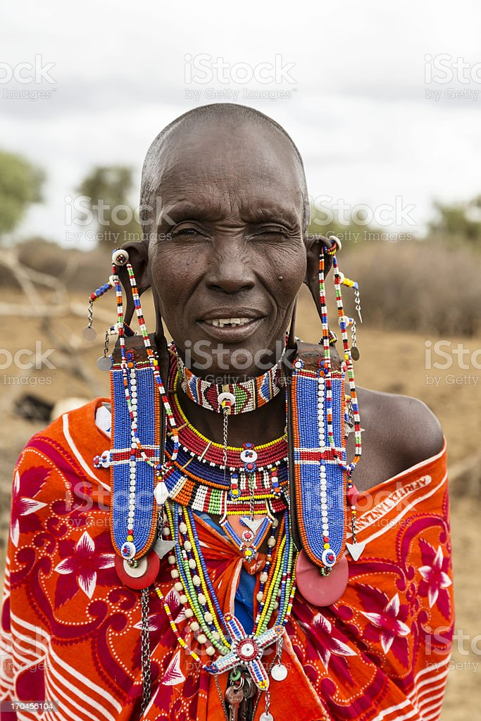 Old maasai woman with impressive traditional colorful pearl jewellery. stock photo