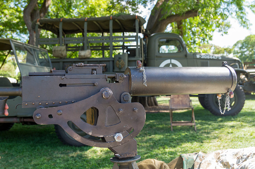 This is a old machine gun from World War 1.  This was on display along with some military vehicles in a public park as part of a 4th of July celebration.