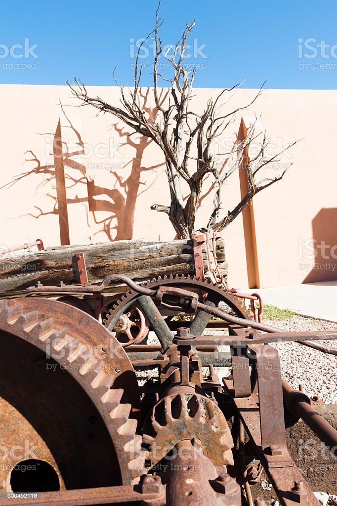 old machinery dead tree  shadow Gallup New Mexico Route 66. stock photo