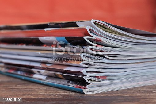 Old magazines on wooden table