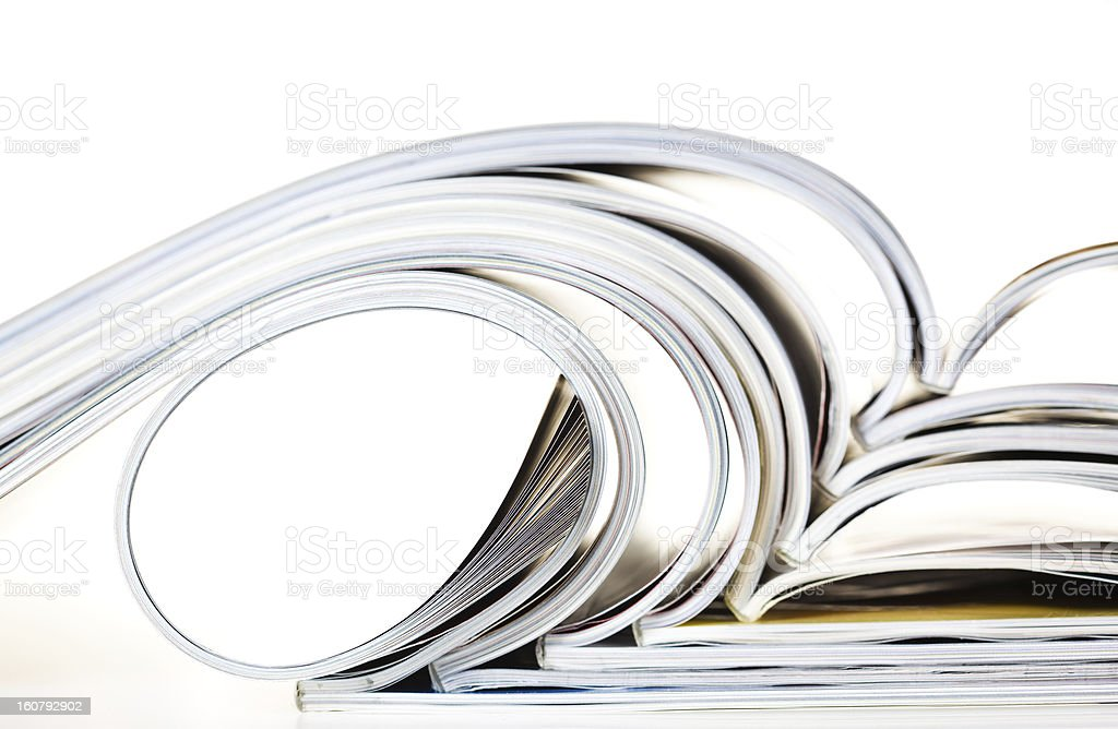 Old magazines with bending pages royalty-free stock photo