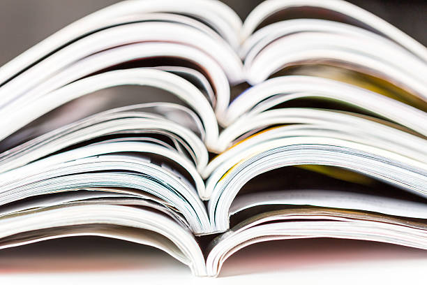 old magazines with bending pages - literature stock pictures, royalty-free photos & images