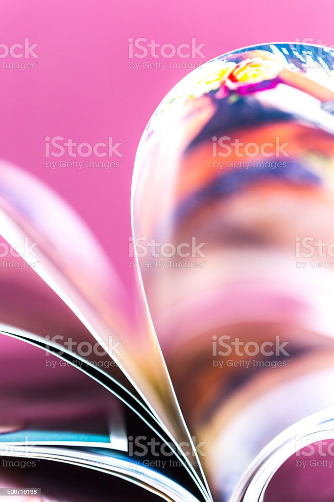 old magazines with bending pages stock photo