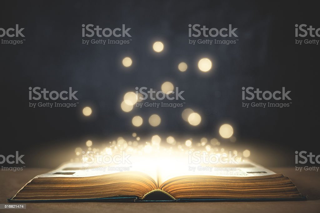 Old magic book and glowing stock photo