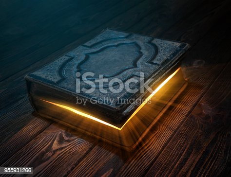 istock Old magic book on the table 955931266