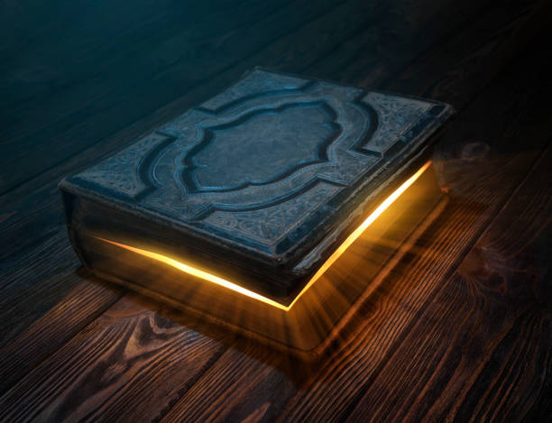Old magic book on the table stock photo