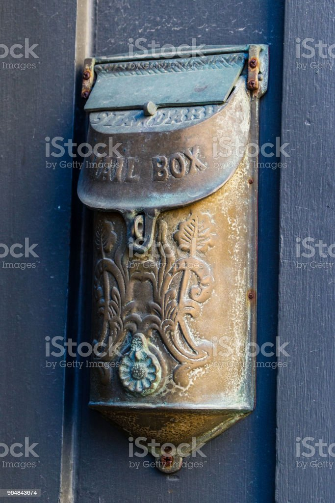 old mail box hanging on an uban building royalty-free stock photo