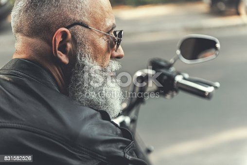 istock Old male person on motorbike 831582526