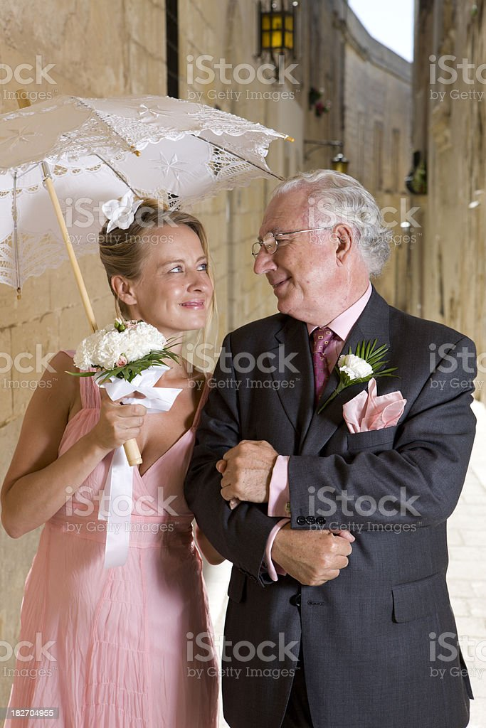 Old man and beautiful woman royalty-free stock photo