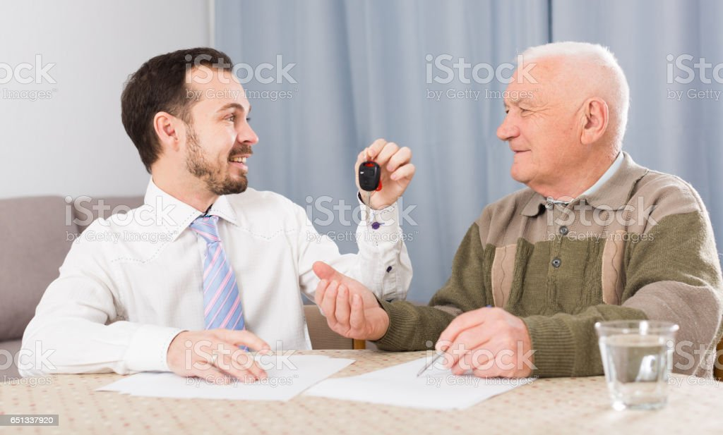 Old man and manager signed contract car lease stock photo