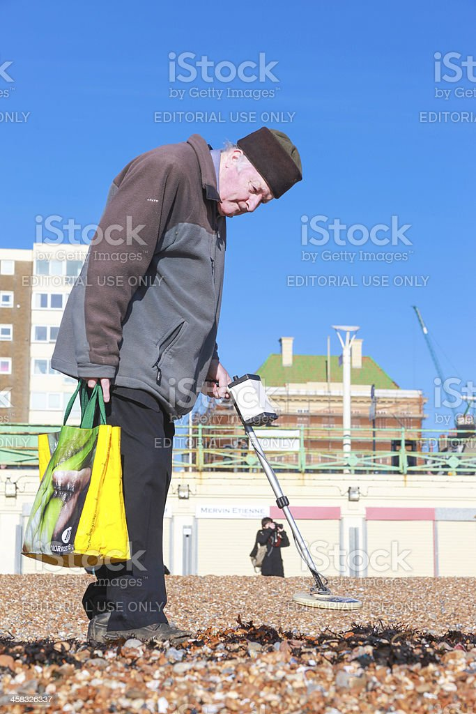 Old man and metal detector royalty-free stock photo