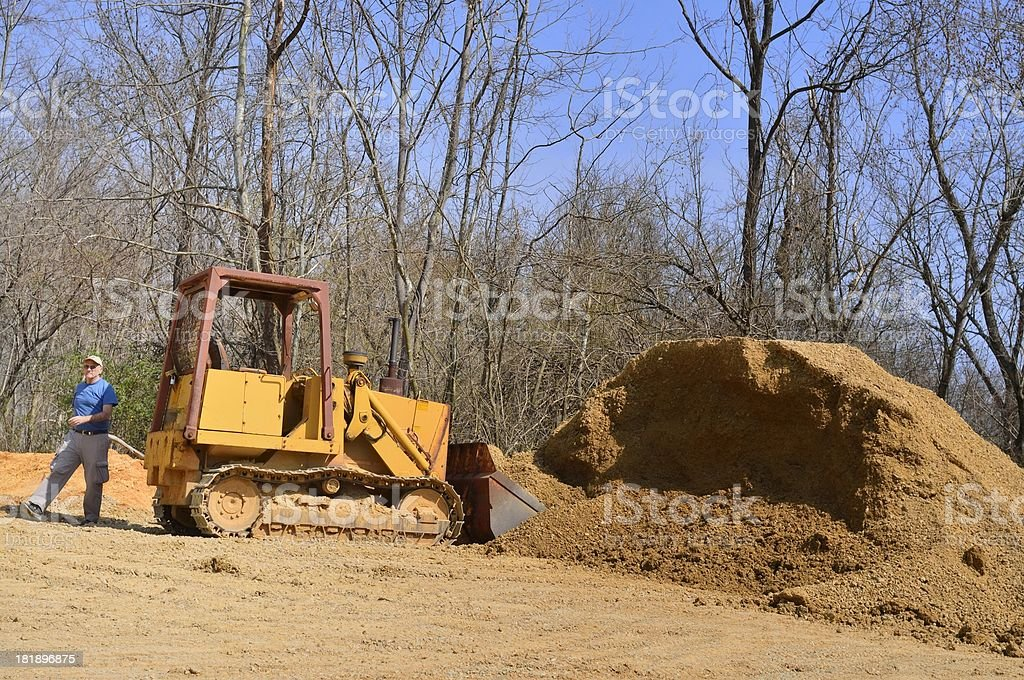Old Man And The Front-end Loader stock photo