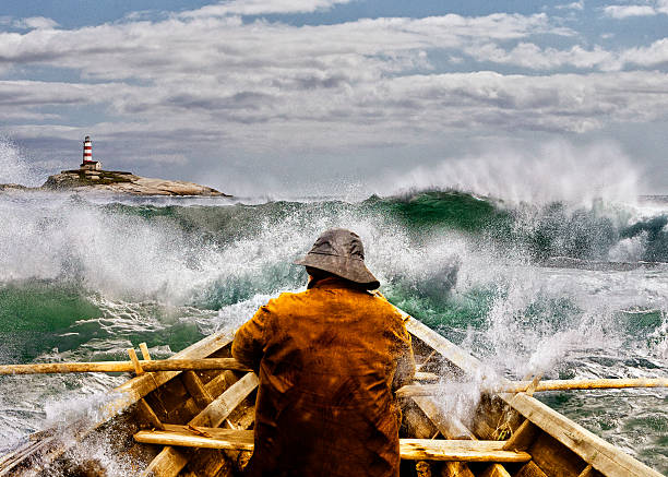 Old man and the Sea in a Skiff Old man and the sea in a rowboat or skiff paddling and fighting the waves of the ocean. sailor stock pictures, royalty-free photos & images