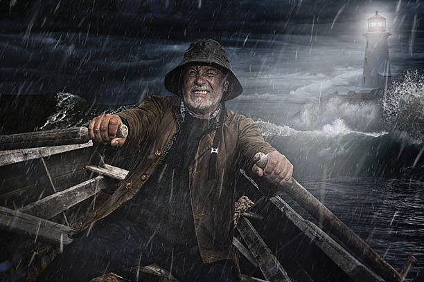 Old Man and the Sea Old Man and the Sea. Salty Dog rowing towards a lighthouse in a storm sailor stock pictures, royalty-free photos & images