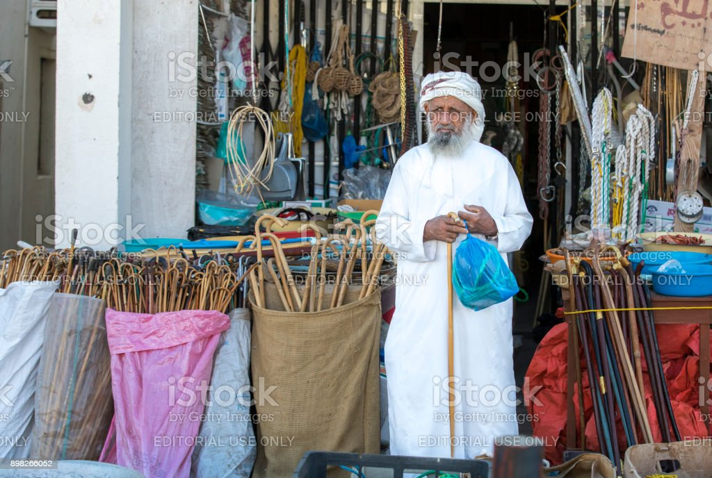 old man at a shop in Sinaw stock photo