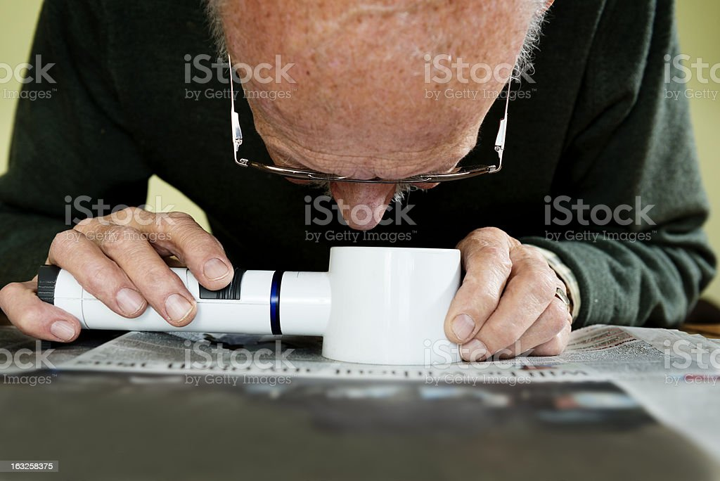 Old Man Dealing With Macular Degeneration stock photo