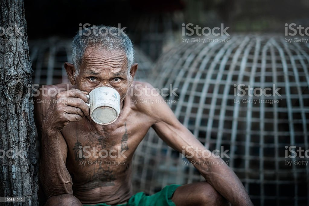 Old man drinking coffee stock photo