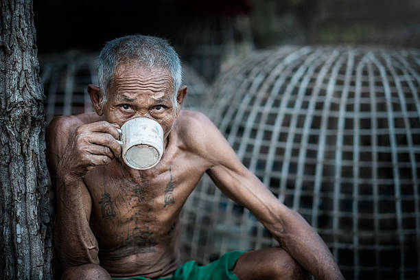 Old man drinking coffee stock photo
