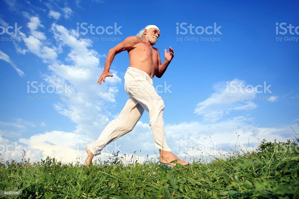 Old man exercise on meadow. royalty-free stock photo