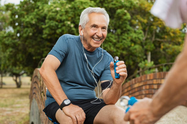 old man exercising using hand gripper - hand grip stock photos and pictures