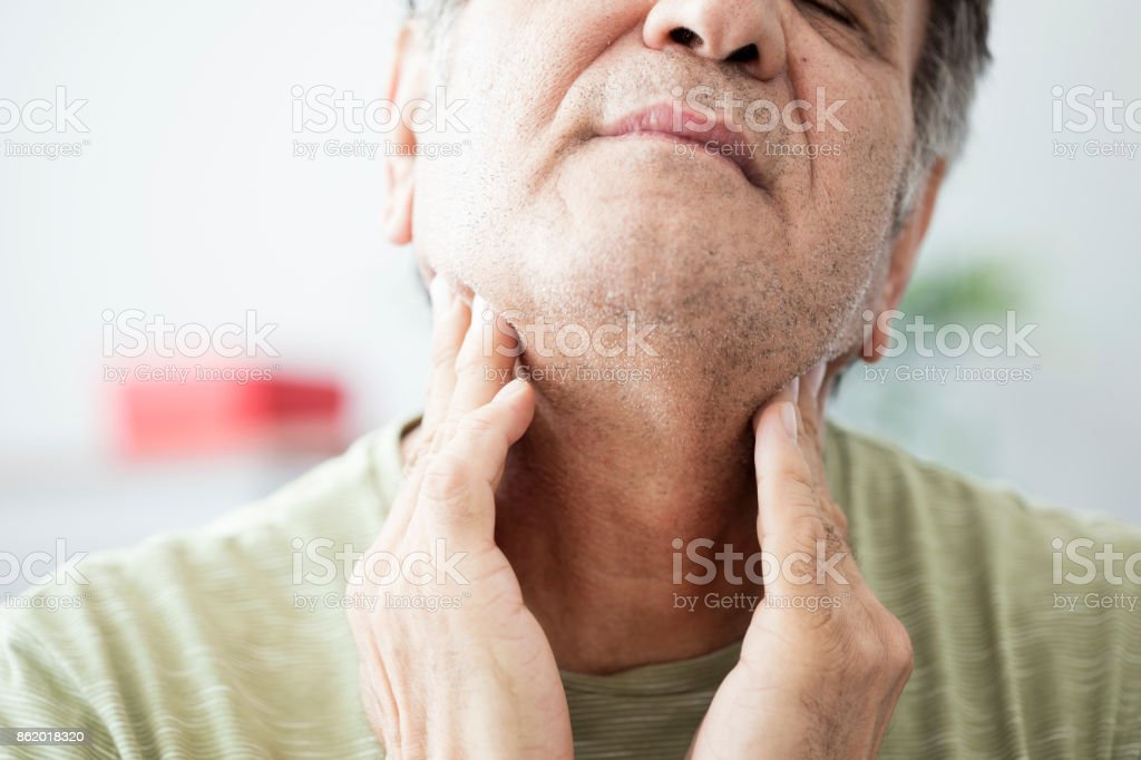 Old man feeling painful in the throat stock photo