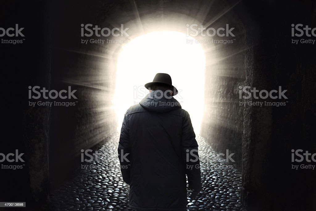 Old man getting out from dark stock photo
