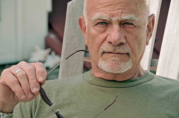 old man glares - mike cherim stock pictures, royalty-free photos & images