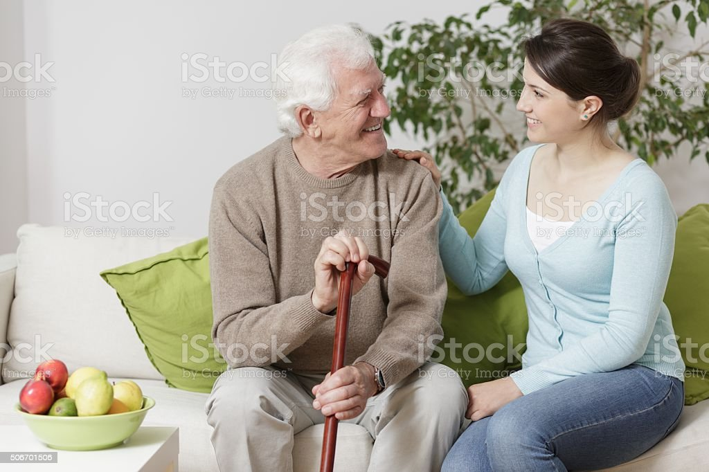Old man holding a cane stock photo