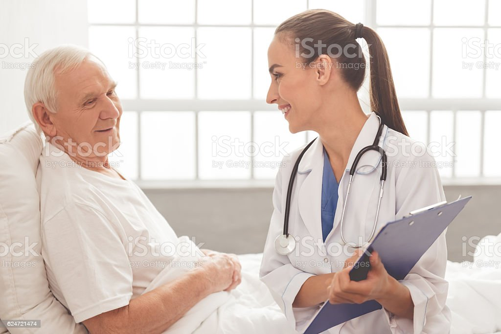 Old man in hospital stock photo