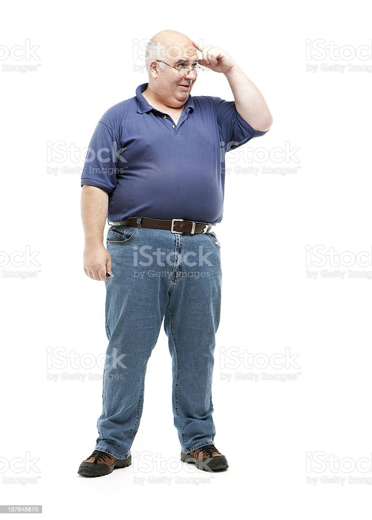 Old man in jeans and polo thinking with hand to his head stock photo