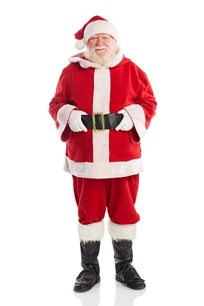 alter mann in santa kostüm, lächelt in die kamera - nikolaus kostüm stock-fotos und bilder
