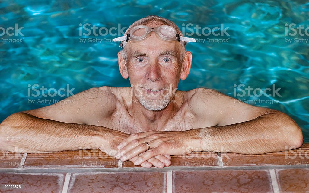 Old man in swimming pool royalty-free stock photo